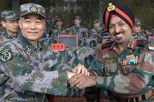 Head of Indian Observer Delegation, Lt Gen Surinder Singh and his Chinese counterpart Lt Gen Zhou Xiaozhou shake hands during commencement of India-China joint exercise 'Hand-in-Hand 2015' at Kunming Military Academy, in Yunnan Province of China.