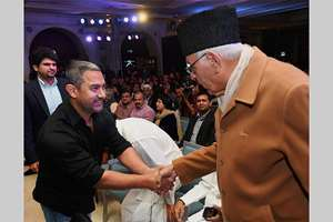Actor Aamir Khan greets National Conference chief Farooq Abdullah at the 8th edition of Ramnath Goenka Excellence in Journalism Awards in New Delhi.