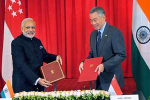 Prime Minister Narendra Modi with his Singapore counterpart Lee Hsien Loong during signing of agreement in Singapore.