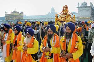 Devotees take part in a religious procession at Golden Temple in Amritsar on the eve of 547th birth anniversary of Sri Guru Nanak Dev.