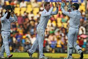South African spinner Simon Harmer celebrates the last wicket of Amit Mishra with D J Vilas on the first day of the third test match between the two countries in Nagpur.