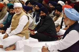 Prime Minister Narendra Modi and former Prime Minister Manmohan Singh at the Gurbani Recital on the occasion of the 547th Birth Anniversary of Guru Nanak Devji at  Rashtrapati Bhavan Cultural Centre, in New Delhi.