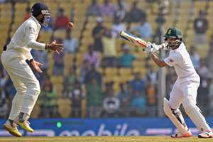 South African batsman J P Duminy plays a shot during the second day of the 3rd test match against Indian in Nagpur.