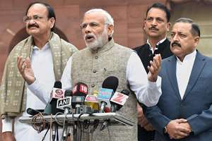 Prime Minister Narendra Modi addressing the media on the opening day of the winter session of  Parliament, in New Delhi. Union Parliamentary affairs Minister Venkaiah Naidu and Minister of State for PMO Jitendra Singh are also seen.