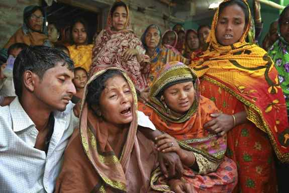 Relatives of people killed as unidentified gunmen attacked a mosque during evening prayers, grieve before their funeral in Bangladesh's Bogra district.