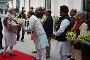 Prime Minister Narendra Modi being felicitated by the party workers as he arrives for the Diwali Mangal Milan programme at BJP headquarters in New Delhi. BJP President Amit Shah is also seen.