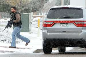 A law enforcement officer secures a perimeter near a deadly shooting at a Planned Parenthood clinic in Colorado Springs. A gunman opened fire at the clinic on Friday, authorities said, wounding multiple people.