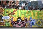 Activists display banners during the Global Climate March in Jakarta, Indonesia. The march is part of a global campaign ahead of next week's U.N. climate talks in Paris.