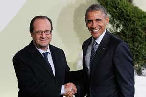 French President Francois Hollande, left, greets U.S. President Barack Obama as he arrives for the COP21, United Nations Climate Change Conference, in Le Bourget, outside Paris.