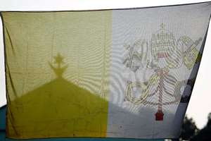 A Vatican flag frames the Central Mosque on the occasion of  Pope Francis visit in Bangui's Muslim enclave of PK5, Central African Republic. The Pope was welcomed by a crowd of people and prayed inside the Central Mosque.