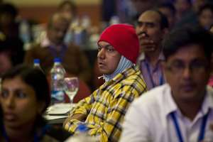 Delegates participate in a leadership summit of HIV affected people, in New Delhi.