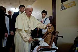 Pope Francis comforts a child during a brief, unscheduled stop at a pediatric hospital on his way to Bangui cathedral, Central African Republic. Pope Francis is in Africa for a six-day visit that is taking him to Kenya, Uganda and the Central African Republic.