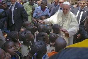 Pope Francis blesses children during his visit at a refugee camp, in Bangui, Central African Republic.