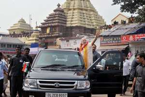 Prime Minister Narendra Modi waves at the crowd during his visit to Jagannath temple in Puri, Odisha