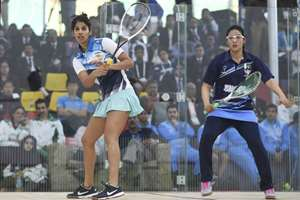 Pakistan's Sadia Gul, right and India's Joshna Chinappa play in the semi final of the women squash event at the South Asian Games in Gauhati, Assam.