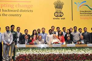 Prime Minister Narendra Modi in group photograph with the youth who have been working in rural areas under Prime Minister's Rural Development Fellows (PMRDF) scheme, in New Delhi.