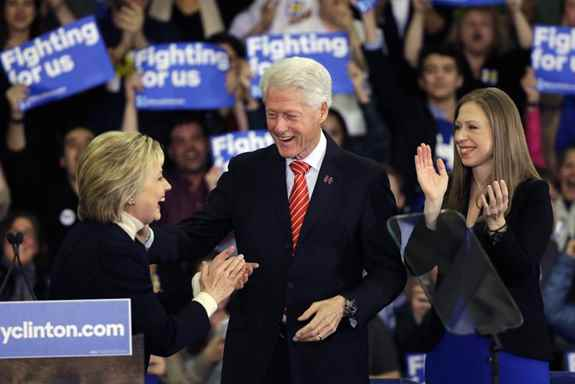 Democratic presidential candidate Hillary Clinton reacts with former President Bill Clinton and daughter Chelsea at her New Hampshire presidential primary campaign rally, in Hooksett, N.H.